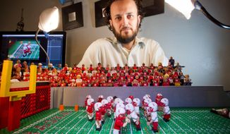 In this Sept. 26, 2016 photo, Jared Jacobs , a stop motion animator, shows one of his college football re-enactments made of Legos in Boise, Idaho.  Jacobs'  work with Legos has gotten him hired by the Big Ten Network to produce 10 mini-movies, one per week during football season. (Kyle Green/Idaho Statesman via AP)