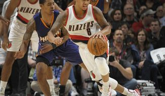 Portland Trail Blazers guard Shabazz Napier dribbles the ball as Phoenix Suns guard Tyler Ulis defends during the fourth quarter of an NBA preseason basketball game in Portland, Ore., Friday, Oct. 7, 2016. The Blazers won 115-110. (AP Photo/Steve Dykes)