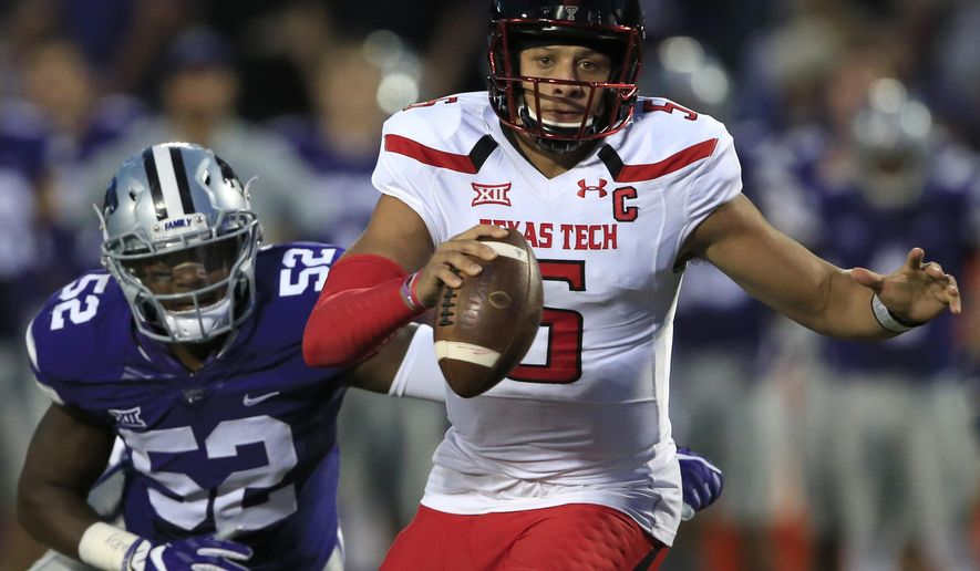 Texas Tech quarterback Patrick Mahomes II (5) runs for a touchdown past Kansas State linebacker Charmeachealle Moore (52) during the first half of an NCAA college football game in Manhattan, Kan., Saturday, Oct. 8, 2016. (AP Photo/Orlin Wagner)