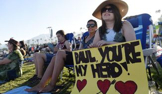 Abby Cooper, 17, of Irvine, Calif. waits for Paul McCartney's set on day 2 of the 2016 Desert Trip music festival at Empire Polo Field on Saturday, Oct. 8, 2016, in Indio, Calif. (Photo by Chris Pizzello/Invision/AP)
