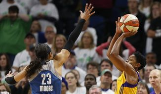 Los Angeles Sparks guard Alana Beard (0) lines up the game winning shot against Minnesota Lynx forward Maya Moore (23) in the second half of Game 1 of the WNBA basketball finals, Sunday, Oct. 9, 2016, in Minneapolis. Los Angeles won 78-76. (AP Photo/Stacy Bengs)