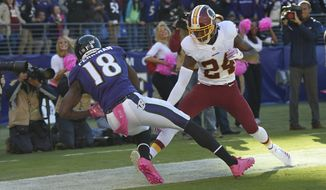 Baltimore Ravens' Breshad Perriman, left, catches an incomplete pass against Washington Redskins' Josh Norman during the second half of an NFL football game, Sunday, Oct. 9, 2016, in Baltimore. Perriman was not able to keep both feet in bounds. Washington won 16-10. (AP Photo/Nick Wass)