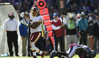 Washington Redskins' Mason Foster reacts during the second half of an NFL football game against the Baltimore Ravens, Sunday, Oct. 9, 2016, in Baltimore. (AP Photo/Gail Burton)
