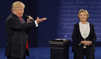 Donald Trump speaks with Hillary Clinton on Sunday during the second presidential debate at Washington University in St. Louis. (Associated Press)