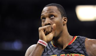 Atlanta Hawks center Dwight Howard plays in the first half of an NBA basketball preseason game Thursday, Oct. 6, 2016, in Memphis, Tenn. (AP Photo/Brandon Dill)