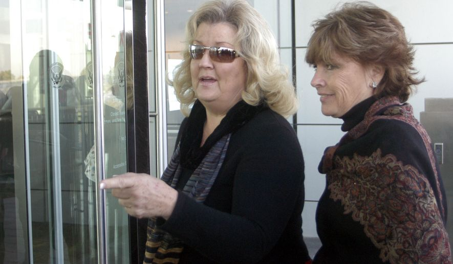 Juanita Broddrick (left) and Kathleen Willey, who accused former President Clinton of sexual misconduct, enter Clinton's presidential library Wednesday, Oct. 26, 2005 in Little Rock, Ark. (Associated Press) ** FILE **