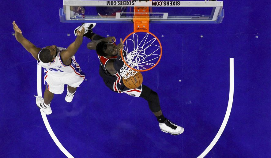 Washington Wizards' Daniel Ochefu in action during a preseason NBA basketball game against the Philadelphia 76ers, Thursday, Oct. 6, 2016, in Philadelphia. (AP Photo/Matt Slocum)