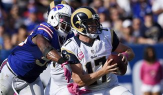 Buffalo Bills outside linebacker Jerry Hughes, left, pressures Los Angeles Rams quarterback Case Keenum, right, during the second half of an NFL football game Sunday, Oct. 9, 2016, in Los Angeles. (AP Photo/Kelvin Kuo)