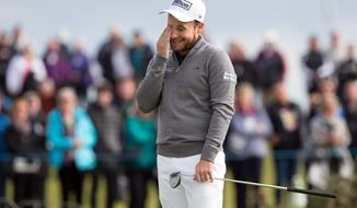 England's Tyrell Hatton misses a birdie on the 1st green on day four of the Alfred Dunhill Links Championship at St Andrews, Scotland, Sunday Oct. 9, 2016. (Kenny Smith/PA via AP) UNITED KINGDOM OUT