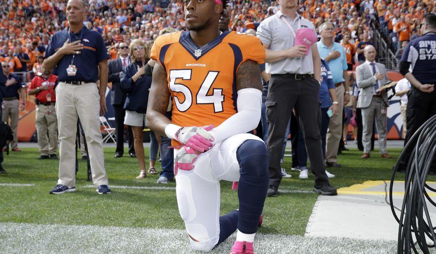 Denver Broncos inside linebacker Brandon Marshall (54) kneels during the national anthem prior to an NFL football game against the Atlanta Falcons, Sunday, Oct. 9, 2016, in Denver. (AP Photo/Jack Dempsey)
