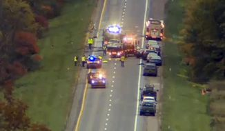 In this still image from video provided by WCAX-TV, workers remove vehicles from Interstate 89 early Sunday, Oct. 9, 2016, in Williston, Vt., after a wrong-way driver caused a crash just before midnight that killed multiple people, before stealing a police cruiser, striking several vehicles and injuring several people.  (WCAX-TV via AP)