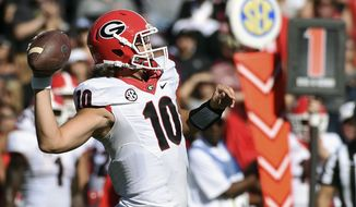 Georgia quarterback Jacob Eason (10) throws a pass during the first half of an NCAA college football game against South Carolina on Sunday, Oct. 9, 2016, in Columbia, S.C. (AP Photo/Rainier Ehrhardt)