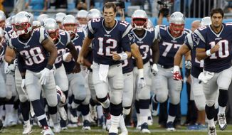 "FILE - In this Aug. 28, 2015, file photo, New England Patriots' Tom Brady (12) leads his team onto the field before a preseason NFL football game against the Carolina Panthers in Charlotte, N.C. The last thing the Browns need right now is a ticked-off superstar quarterback making his return to the NFL. While the ``Deflategate"" saga might never be forgotten, it's behind the New England Patriots and their four-time Super Bowl champion QB. And, for sure, Brady won't have forgotten the four-game punishment from Commissioner Roger Goodell that he fought to overturn and eventually had to serve. (AP Photo/Bob Leverone, File)"