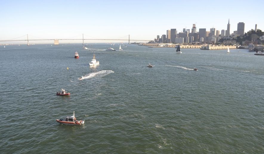 In this Saturday, Oct. 8, 2016, photo released by the  U.S. Coast Guard District 11, shows several Coast Guard assets clean up debris left behind by the 34-foot recreational sailboat, Khaleesi, which capsized near Pier 45 just north of San Francisco. The Khaleesi had 30 people aboard who were rescued by various Coast Guard assets, partner agencies and good Samaritans. (Petty Officer 2nd Class Chris Parrinello/U.S. Coast Guard via AP)
