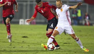 Albania's Elseid Hysaj fight for the ball with Spain's Andres Iniesta, right, during their World Cup Group G qualifying soccer match at Loro Borici Stadium, in Shkoder, northern Albania, on Sunday, Oct. 9, 2016. (AP Photo/Hektor Pustina)