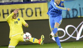 Kosovo's Leart Paqarada, left, challenges Ukraine's Andriy Yarmolenko during their World Cup Group I qualifying soccer match at the Jozef Pilsudski Stadium in Krakow, Poland, Sunday, Oct. 9, 2016. (AP Photo/Alik Keplicz)