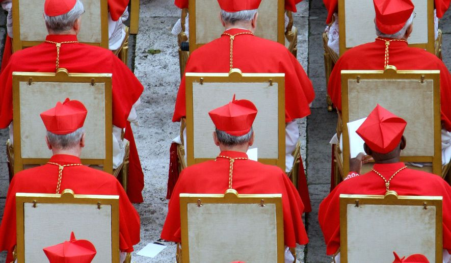 FILE - This March 24, 2006 file photo shows Cardinals during a consistory led by Pope Benedict XVI to elevate 15 new cardinals in St. Peter's Square at the Vatican. Pope Francis names 17 new cardinals, 13 of them electors including three Americans; sets ceremony Nov. 19, 2016. (AP Photo/Andrew Medichini, File)