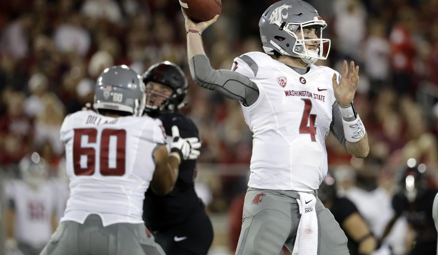 Washington State quarterback Luke Falk (4) throws against Stanford during the first half of an NCAA college football game Saturday, Oct. 8, 2016, in Stanford, Calif. (AP Photo/Marcio Jose Sanchez)