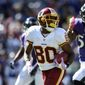 Washington Redskins' Jamison Crowder received strong blocking from teammates on his 85-yard punt return touchdown on Sunday. (Associated PRess)