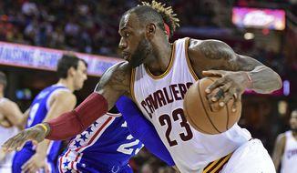 Cleveland Cavaliers forward LeBron James (23) drives on Phildelphia 76ers forward James Webb III (23) in the first half of an NBA preseason basketball game Saturday, Oct. 8, 2016, in Cleveland. (AP Photo/David Dermer)