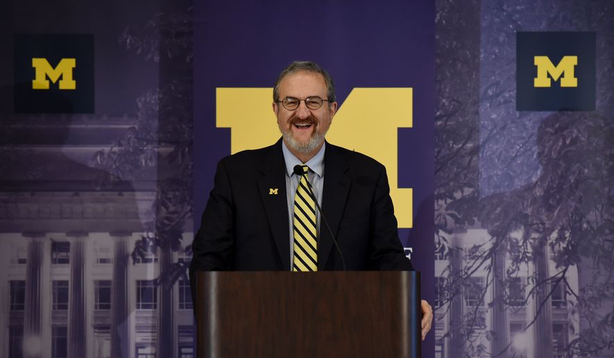 In this Wednesday, Oct. 5, 2016 photo, University of Michigan president Mark Schlissel speaks during the annual Leadership Breakfast at the Michigan Union at the University of Michigan, in Ann Arbor, Mich.The University of Michigan unveiled an $85 million, five-year plan on Thursday, Oct. 6, 2016, to promote diversity and inclusion Thursday, just days after racist flyers posted at the mostly white Ann Arbor campus caused unease among some black students ( Melanie Maxwell/The Ann Arbor News via AP)