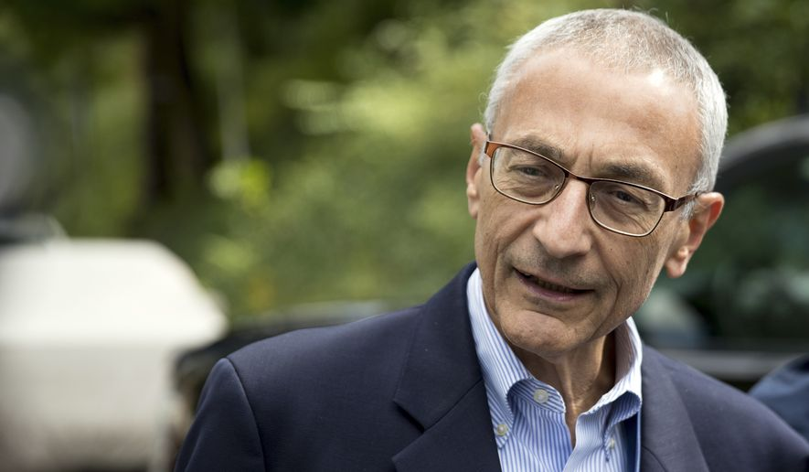 In this Oct. 5, 2016, file photo, Hillary Clinton campaign chairman John Podesta speaks to members of the media outside Clinton's home in Washington. (AP Photo/Andrew Harnik) ** FILE **