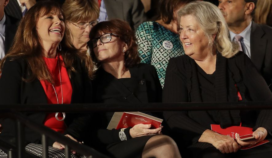 Paula Jones, left, talks Kathleen Willey and Juanita Broaddrick before the second presidential debate at Washington University in St. Louis, Sunday, Oct. 9, 2016. (AP Photo/Julio Cortez)