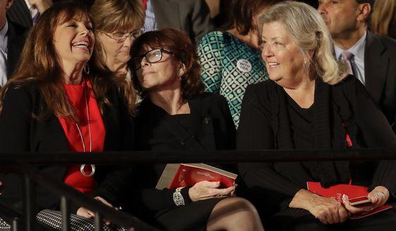 Paula Jones, left, talks Kathleen Willey and Juanita Broaddrick before the second presidential debate at Washington University in St. Louis, Sunday, Oct. 9, 2016. (AP Photo/Julio Cortez)