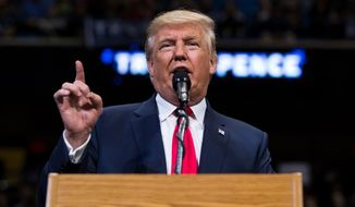 Republican Presidential nominee Donald J. Trump delivers remarks during a rally at Mohegan Sun Arena in Wilkes-Barre Twp., Pa. on Monday, Oct. 10, 2016. (Christopher Dolan / The Citizens' Voice via AP)