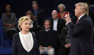 Democratic presidential nominee Hillary Clinton, reacts as Republican presidential nominee Donald Trump during the second presidential debate at Washington University in St. Louis, Sunday, Oct. 9, 2016. (Saul Loeb/Pool via AP)