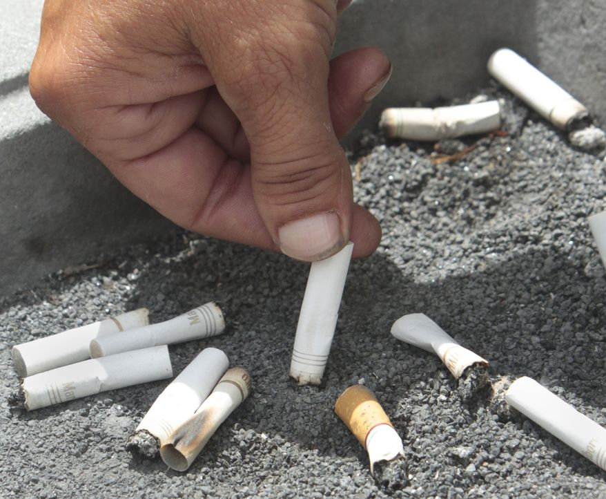 FILE - In this June 22, 2012, file photo, a smoker snuffs out a cigarette. (AP Photo/Rich Pedroncelli, File)