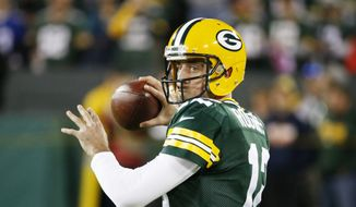 Green Bay Packers' Aaron Rodgers warms up before an NFL football game against the New York Giants Sunday, Oct. 9, 2016, in Green Bay, Wis. (AP Photo/Mike Roemer)