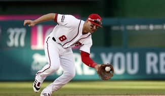 Washington Nationals shortstop Danny Espinosa (8) fields a ground ball during Game 2 of baseball's National League Division Series against the Los Angeles Dodgers, at Nationals Park, Sunday, Oct. 9, 2016, in Washington. The Nationals won 5-2.(AP Photo/Alex Brandon) **FILE**