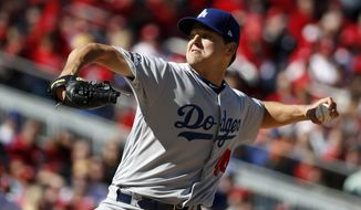 Los Angeles Dodgers starting pitcher Rich Hill throws in Game 2 of baseball's National League Division Series against the Washington Nationals, at Nationals Park, Sunday, Oct. 9, 2016, in Washington. (AP Photo/Alex Brandon)