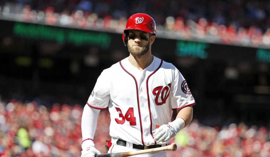 Washington Nationals right fielder Bryce Harper (34) reacts after batting in Game 2 of baseball's National League Division Series against the Los Angeles Dodgers, at Nationals Park, Sunday, Oct. 9, 2016, in Washington. (AP Photo/Alex Brandon)