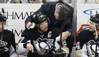 FILE - In this Feb. 2, 2016, file photo, Pittsburgh Penguins' Sidney Crosby (87) talks with head coach Mike Sullivan during an NHL hockey game against the Ottawa Senators in Pittsburgh. Pittsburgh Penguins superstar Sidney Crosby has been diagnosed with another concussion and there is no timetable for his return. General manager Jim Rutherford made the announcement Monday, Oct. 10, 2016,  as the team prepared for its regular-season opener Thursday night at home against Washington.(AP Photo/Gene J. Puskar, File) **FILE**