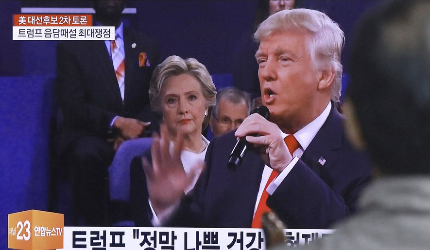The presidential debate between Democrat Hillary Clinton and Republican Donald Trump on Sunday was broadcast live in South Korea. (Associated Press)