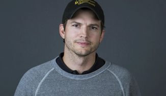 "In this Oct. 6, 2016 photo, Ashton Kutcher poses for a portrait to promote the second season of his Netflix series, ""The Ranch,"" in New York. (Photo by Amy Sussman/Invision/AP)"