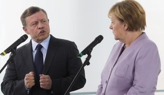 German Chancellor Angela Merkel, right, and King Abdullah II, of Jordan, brief the media prior to talks at the chancellery in Berlin, Friday, Oct. 7, 2016. (AP Photo/Markus Schreiber)