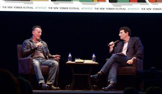 "This Oct. 7, 2016 photo released by The New Yorker shows singer Bruce Springsteen, left, speaking with moderator David Remnick about his life and career, and his new memoir, ""Born to Run,"" during the annual New Yorker Festival in New York.  (Sean Walsh/The New Yorker via AP)"