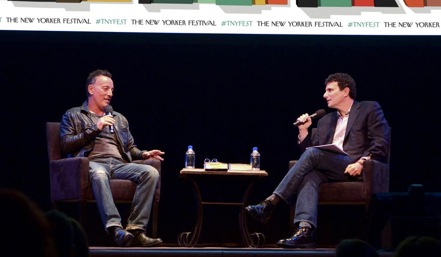 """This Oct. 7, 2016 photo released by The New Yorker shows singer Bruce Springsteen, left, speaking with moderator David Remnick about his life and career, and his new memoir, """"Born to Run,"""" during the annual New Yorker Festival in New York.  (Sean Walsh/The New Yorker via AP)"""