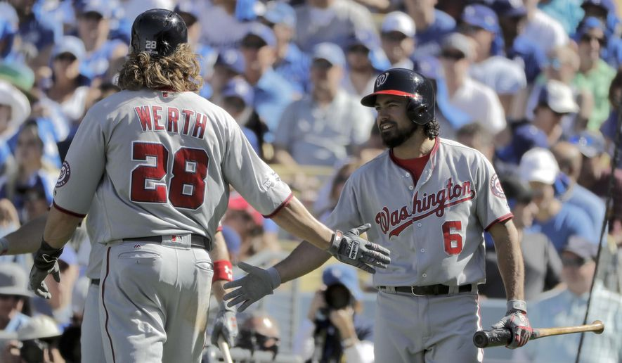 Washington Nationals' Jayson Werth, left, celebrates with Anthony Rendon after scoring on a single by Bryce Harper during the third inning in Game 3 of baseball's National League Division Series in Los Angeles, Monday, Oct. 10, 2016.  (AP Photo/Jae C. Hong)