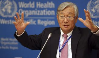 World Health Organization Regional Director Shin Young-soo gestures as he answers questions from reporters in Manila, Philippines Monday, Oct. 10, 2016. WHO officials say cases of the mosquito-born Zika virus infection are expected to continue to rise in Asia Pacific and regional health authorities are scaling up surveillance, preparing responses to complications and collaborating to come up with answers to many questions about the disease. (AP Photo/Aaron Favila)