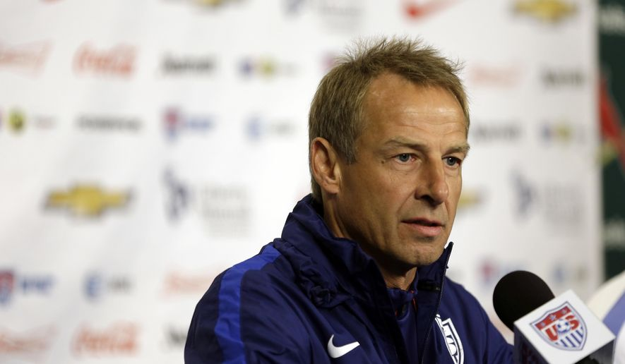FILE - This Nov. 12, 2015 file photo shows U.S. men's national soccer team coach Jurgen Klinsmann taking part in a news conference in St. Louis. Klinsmann rejects Bob Bradley's claims that he angled to success him as U.S. coach while working as an ESPN analyst during the 2010 World Cup. Bradley made the claim when he was introduced as Swansea, the first American head coach in England's Premier League. (AP Photo/Jeff Roberson, file)