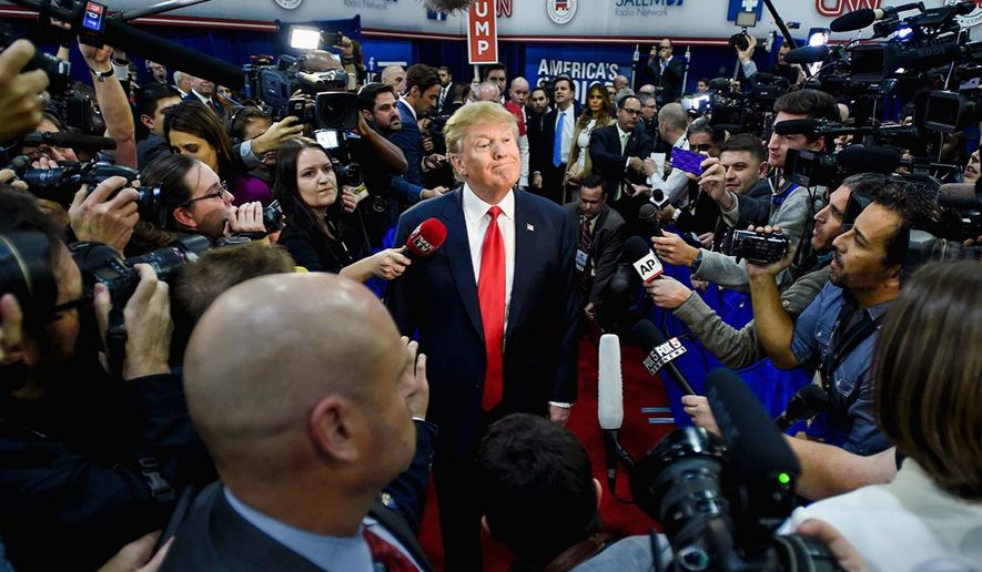 Donald Trump faces the press on the campaign trail in Las Vegas. (Associated press)