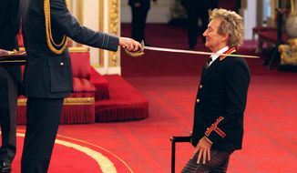 Veteran singer Sir Rod Stewart, right, is made a Knights Batchelor by Britain's William, the Duke of Cambridge, during an Investiture ceremony at Buckingham Palace in London, Tuesday Oct. 11, 2016. (Jonathan Brady/PA via AP)