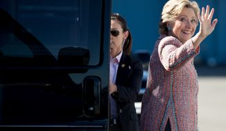 Democratic presidential candidate Hillary Clinton boards her campaign plane at Westchester County Airport in White Plains, N.Y., Tuesday, Oct. 11, 2016, to travel to Miami. (AP Photo/Andrew Harnik)