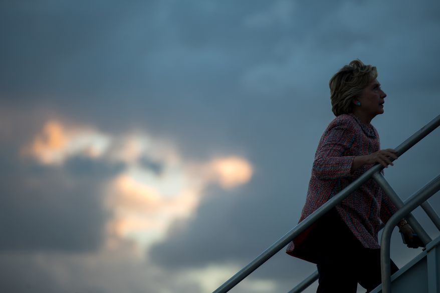 Democratic presidential candidate Hillary Clinton boards her campaign plane at Miami International Airport in Miami, Tuesday, Oct. 11, 2016, to travel to White Plains, N.Y. (AP Photo/Andrew Harnik)