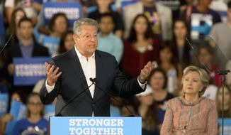 Former Vice President Al Gore speaks as Democratic presidential candidate Hillary Clinton listens, at a rally at Miami Dade College in Miami, Tuesday, Oct. 11, 2016. (Mike Stocker/South Florida Sun-Sentinel via AP)