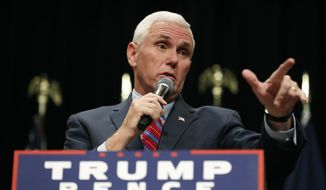Republican vice presidential candidate Indiana Gov. Mike Pence speaks during a campaign rally, Tuesday, Oct. 11, 2016, in Newton, Iowa. (AP Photo/Charlie Neibergall)
